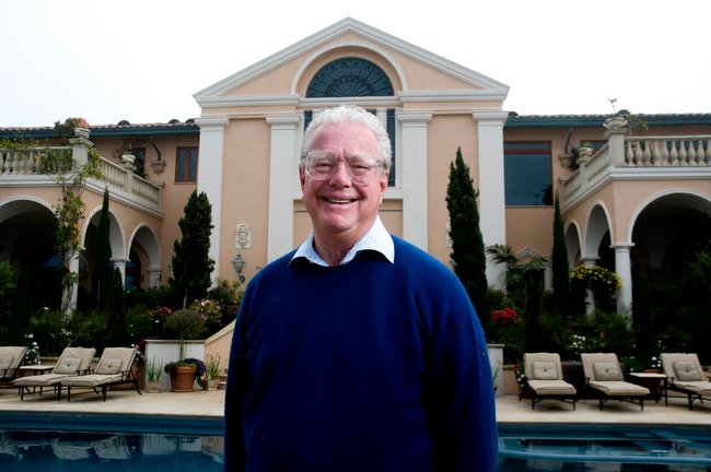 Bill Lerach stands outside his mansion in La Jolla.