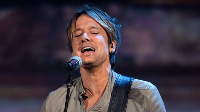 """LOS ANGELES, CA - JANUARY 27: Recording artist Keith Urban performs onstage during """"The Night That Changed America: A GRAMMY Salute To The Beatles"""" at the Los Angeles Convention Center on January 27, 2014 in Los Angeles, California. (Photo by Kevin Winter/Getty Images for NARAS)"""