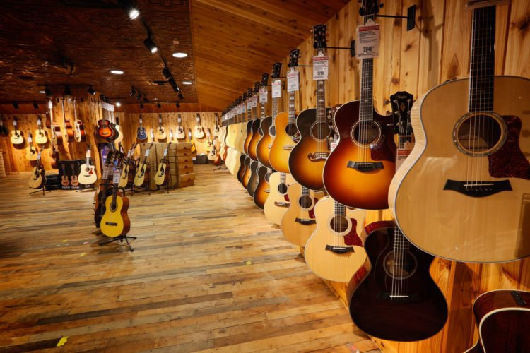 Guitar Center loses $11 million, fires 100+ employees