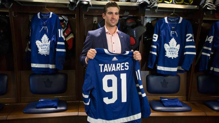 John Tavares holds Maple Leafs jersey