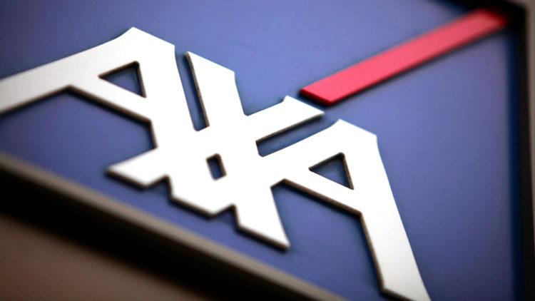 AXA RESOLUTION SALE...The Axa SA company logo sits outside the o