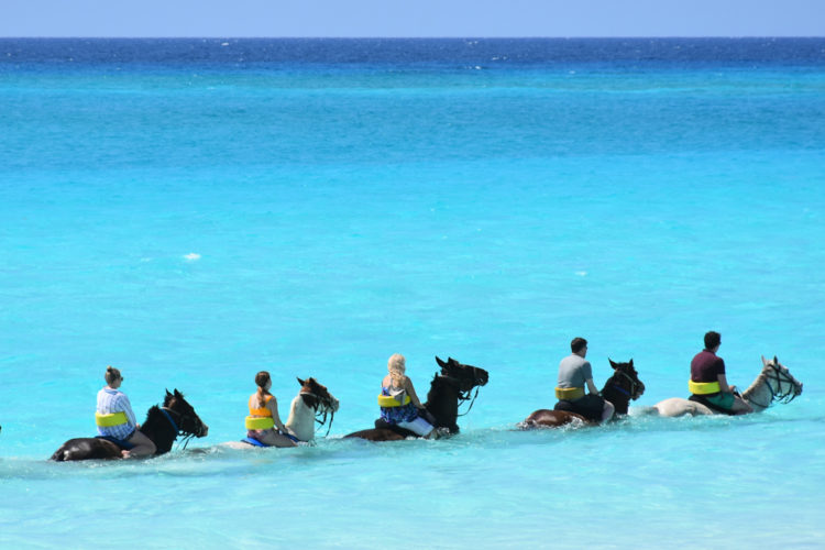 Take a horseback ride and swim in the Caribbean Ocean