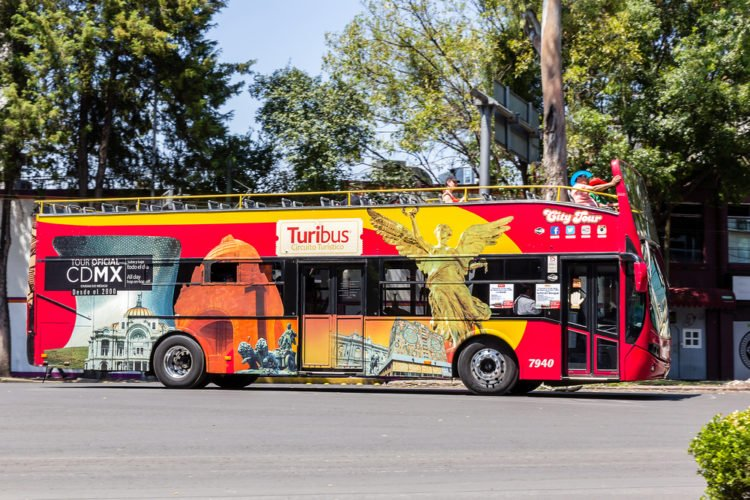 Take the Carnivalito Bus City Tour