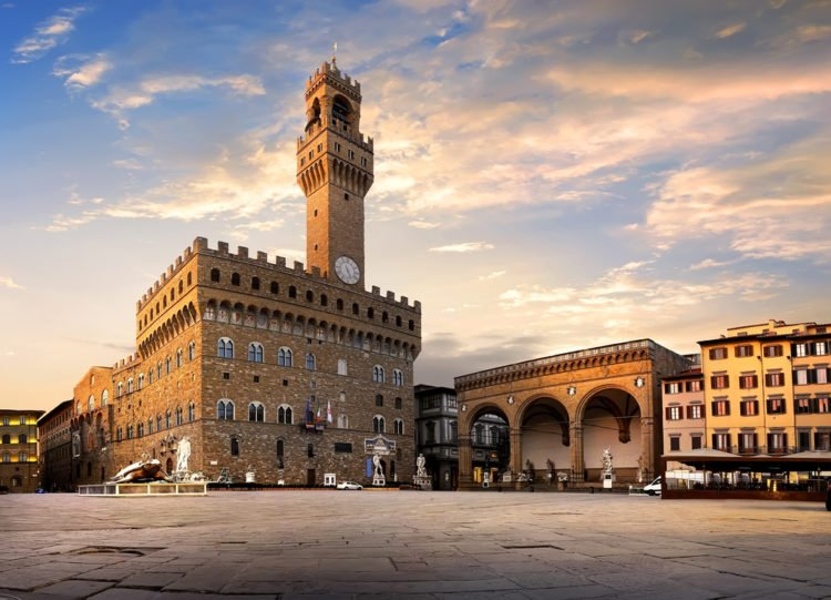 Have lunch at Piazza della Loggia